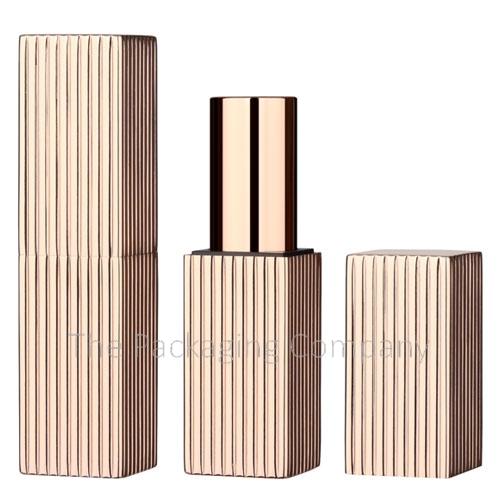 Square aluminum lipstick case with magnetic closure, ribbed design.