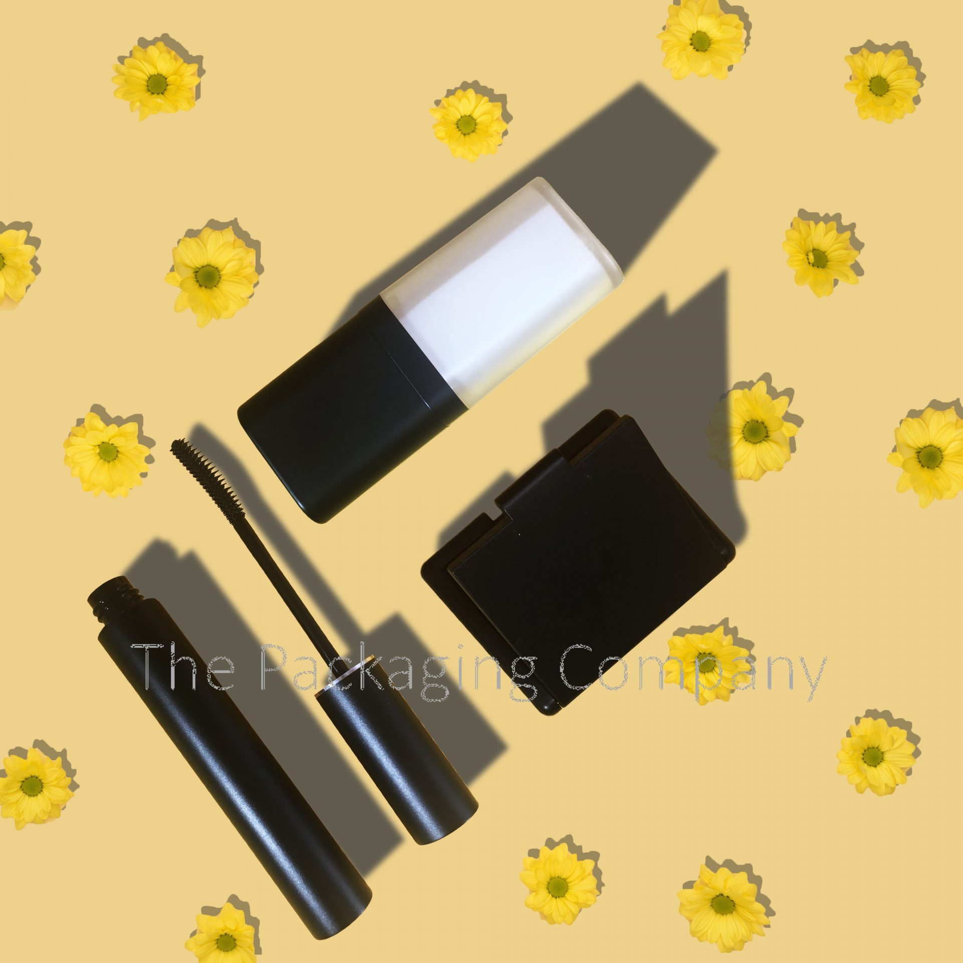 Cosmetic bottle, compact, and mascara on a yellow flower background
